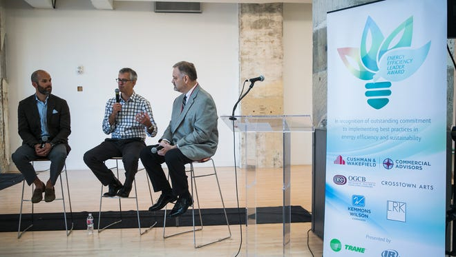 October 9, 2017 - Todd Richardson, co-founder and managing director of Crosstown Arts, is flanked by McLean Wilson, principal at Kemmons Wilson Companies, left, and Dan Chancey, senior vice president, asset management, commercial advisors at Cushman and Wakefield, as he speaks during an energy efficiency leader award presentation for Crosstown Concourse partners at Crosstown Concourse on Monday. The event was held to recognize Crosstown Concourse partners for their commitment to implementing best practices in energy efficiency and sustainability.