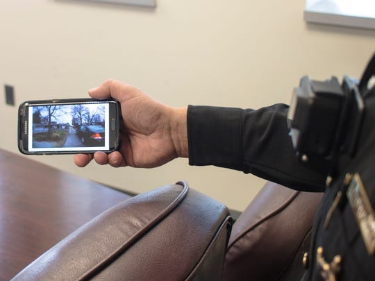 Ottawa County Sheriff Steve Levorchick demonstrates how video evidence taken from the body cameras by Intrensic can be accessed and reviewed from virtually anywhere, such as on a cellphone, with the cloud-based storage. The Sandusky County Sheriff's Office is interested in using similar cameras that would allow the sheriff's office to be more transparent.