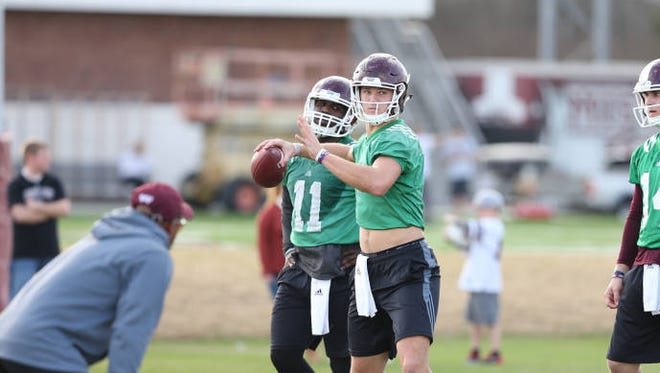 Mississippi State quarterbacks Damian Williams (background) and Nick Fitzgerald work to fill the hiatus left by Dak Prescott.