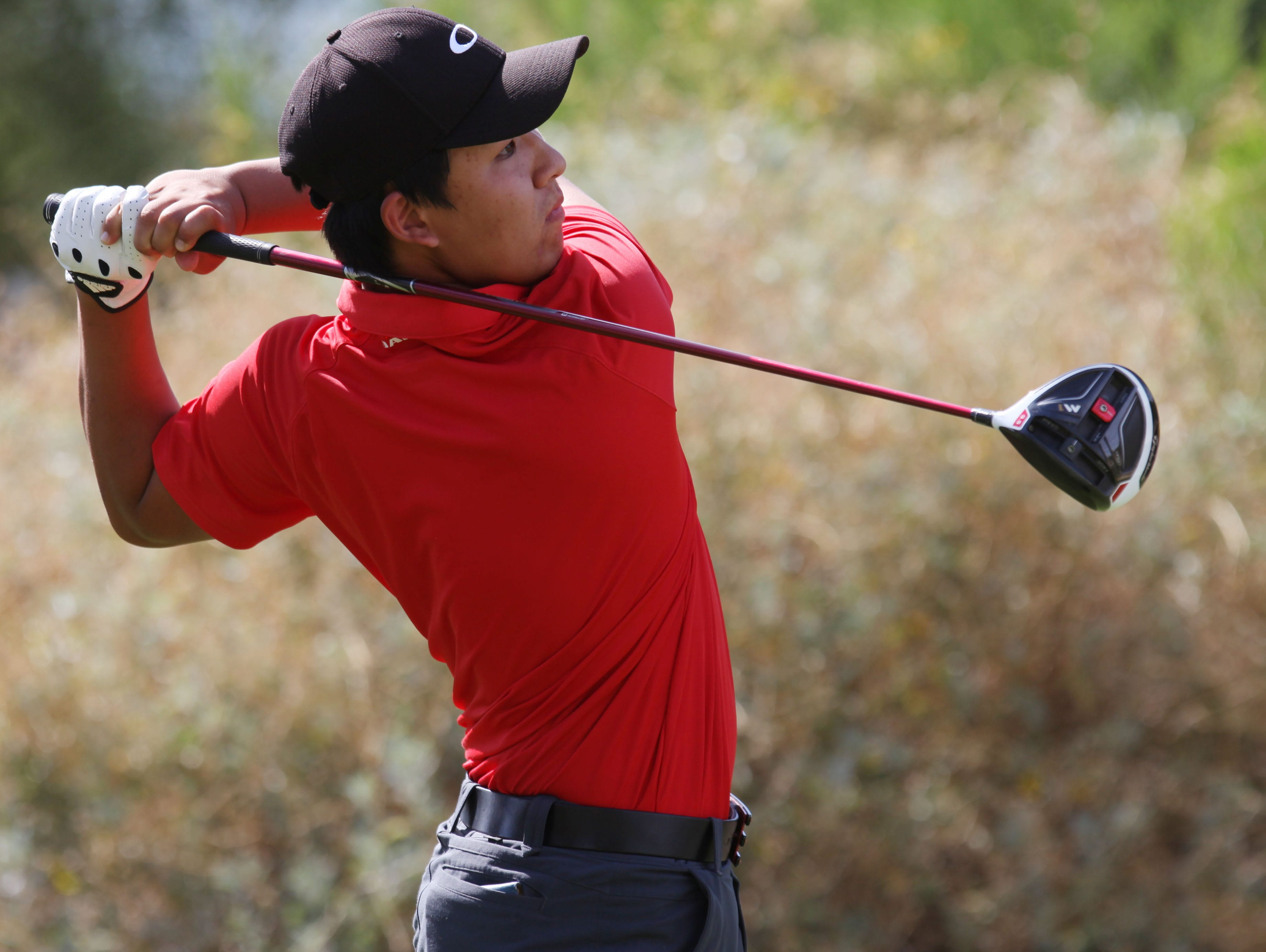 Palm Desert High School's Derrek Liu and his team hosted La Quinta High School's golf team at Desert Willow Country Club in Palm Desert on April 21, 2016.