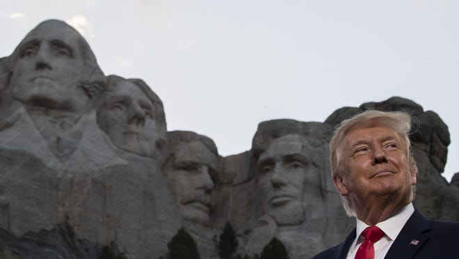 President Donald Trump smiles at Mount Rushmore National Memorial Friday near Keystone, S.D.