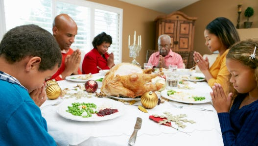Family Celebrating With Thanksgiving Meal