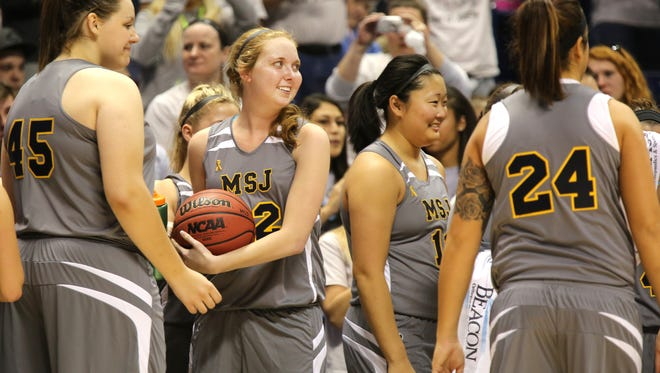 Lauren Hill celebrates with her Mount St. Joseph University basketball teammates on Nov. 2.