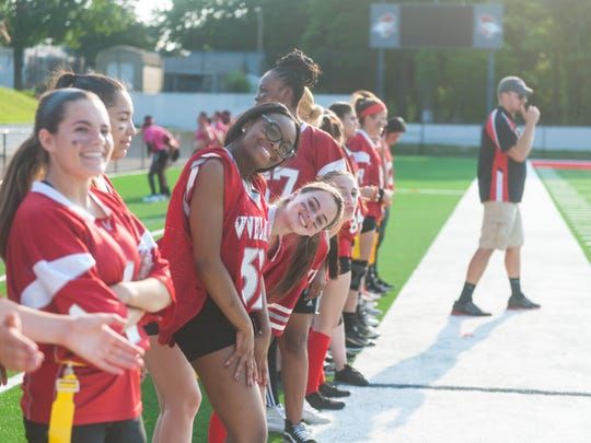 Vineland senior girls watch from the new sidelines