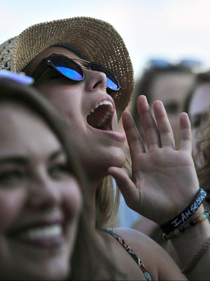 Korisa Warlick and Kyleah Hengesbach, Chapel Hill, Tenn, cheer for City and Colour at The Pilgrimage Music & Cultural Festival in Franklin, Tenn, on Sunday September 25.