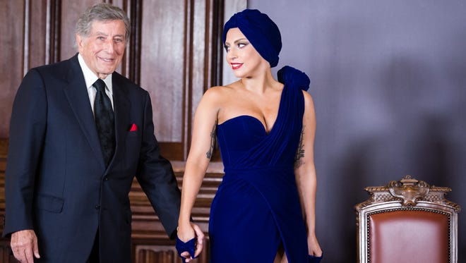 Lady Gaga, right, and Tony Bennett arrive for a media event at the Brussels' city hall on Sept. 22, 2014. The Grammy Awards will feature a number of collaborative performances, including Lady Gaga with Tony Bennett, The Recording Academy said Tuesday, Jan. 27, 2015.