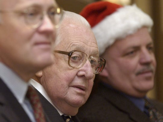 Tony Pomerleau (center) is flanked by Gov. Jim Douglas (left) and Burlington Mayor Peter Clavelle during the 24th annual Pomerleau Family Holiday Party at the Wyndham Burlington on Sunday, Dec. 6, 2004.