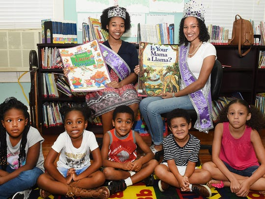 Kylie Leday, Miss Acadiana Magnolia and Kayli Robinson,  Jr. Miss Acadiana Magnolia were guest readers on Wednesday at the Washington Public Library where their summer reading program is now in session.