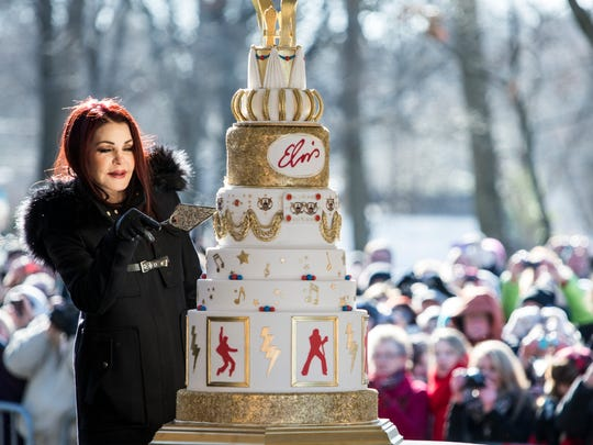 January 08, 2015 - Priscilla Presley begins to cut the eight-tiered birthday cake during the 80th birthday celebration for Elvis Presley at Graceland. A large crowd gathered for the celebration even though the temperature was below 20 degrees.