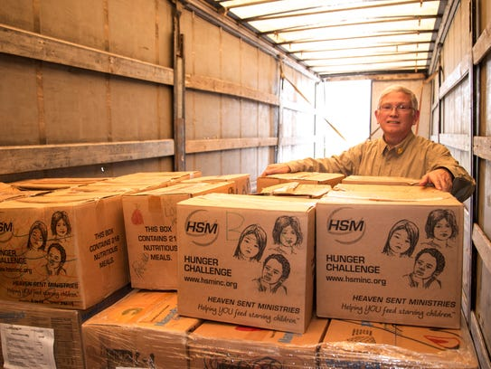 Michael Harbour with boxes of food sent from the Big