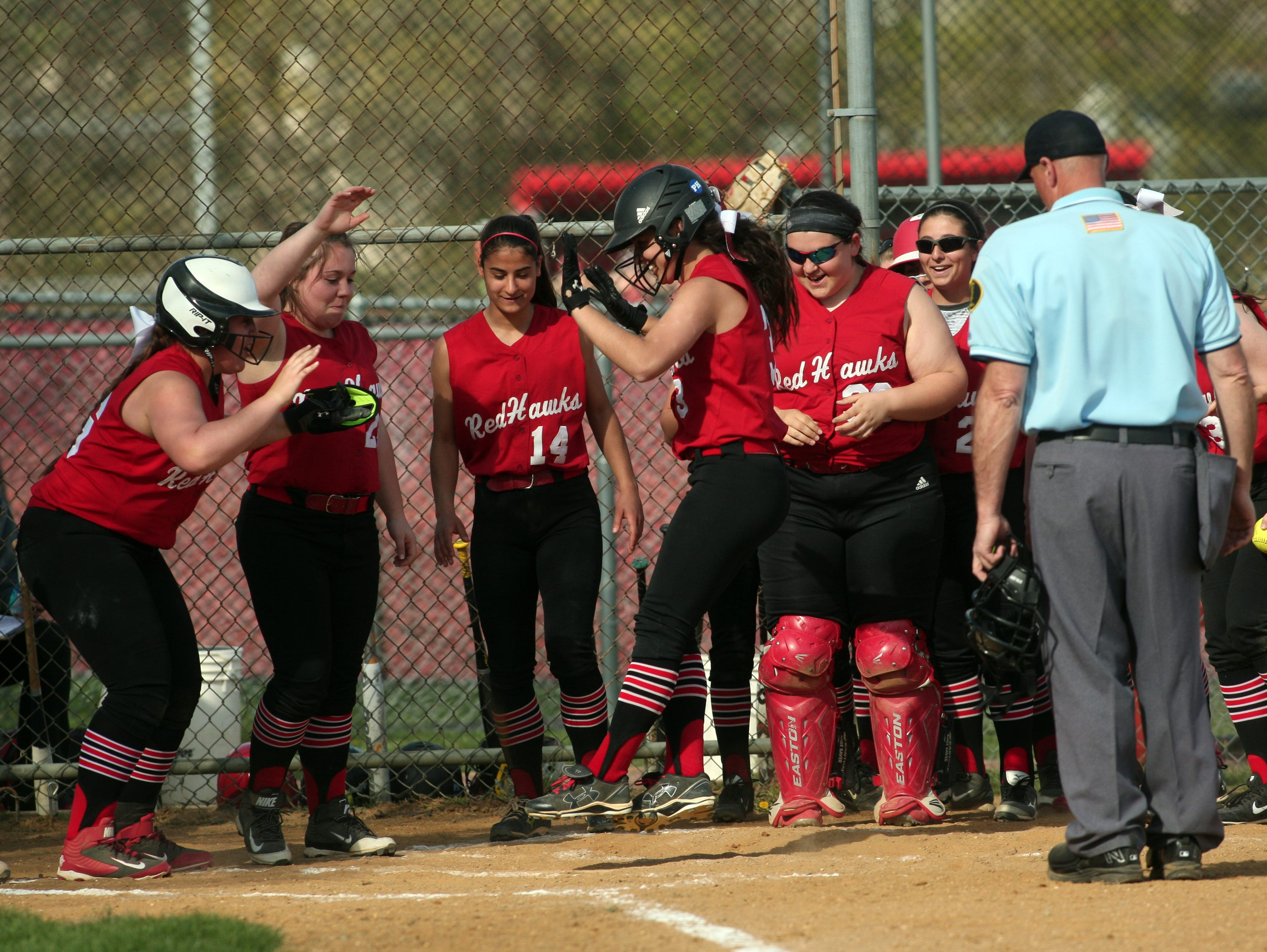 Parsippany's Kaila Migliazza (3) is congratulated after a home run against Mendham during their first round Morris County Tournament game on April 28.