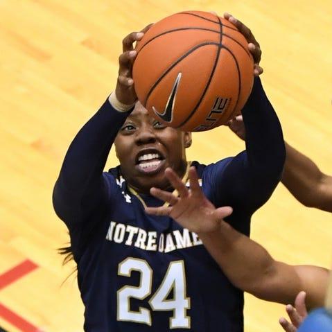 Notre Dame guard Arike Ogunbowale (24) grabs a rebound