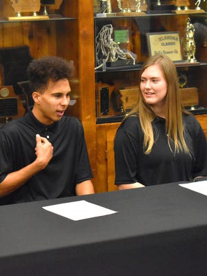 Oklahoma School for the Deaf students Isiah Holt and April Pennel speak to reporters and guests on Wednesday. The students used American Sign Language for their comments, which were then spoken by interpreters.