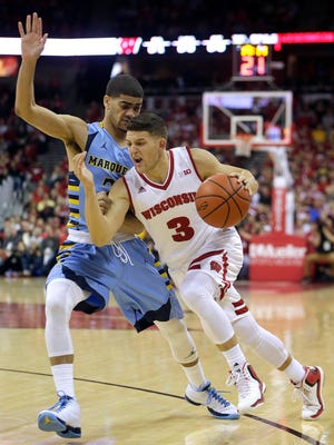 Marquette's Haanif Cheatham and Wisconsin's Zak Showalter will battle again at 1 p.m. Saturday at the BMO Harris Bradley Center.