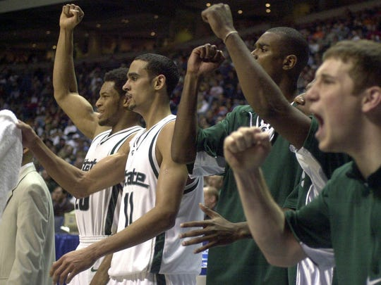 MSU players Aloysius Anagonye, David Thomas, Mike Chappell and Mat Ishbia celebrate during the Spartans' win over Fresno State in the 2001 NCAA tournament.