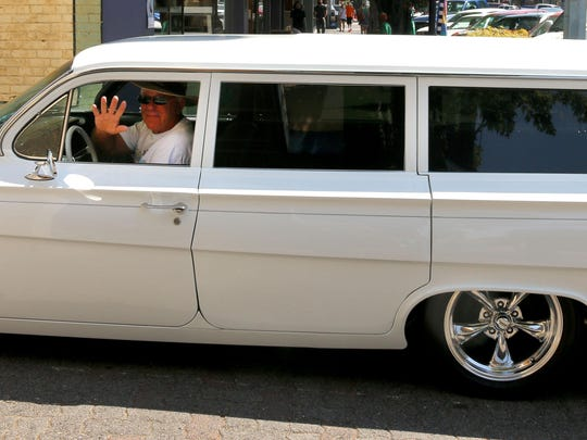 Jim Billings waves from his 1962 Chevy Bel Air wagon, which will be among classic cars around the Capitol Aug. 29.