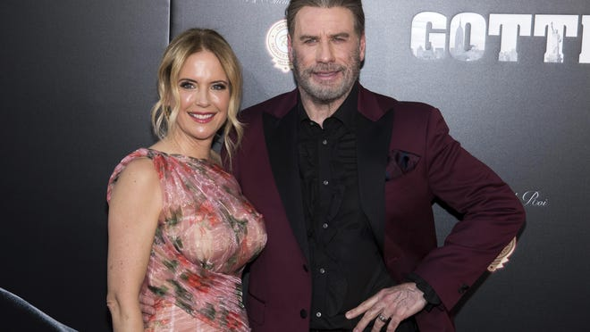 """FILE - In this June 14, 2018, file photo, Kelly Preston and John Travolta attend the premiere of """"Gotti"""" at the SVA Theatre in New York. Preston, whose credits included the films """"Twins†and """"Jerry Maguire,†died Sunday, July 12, 2020, her husband Travolta said. She was 57."""