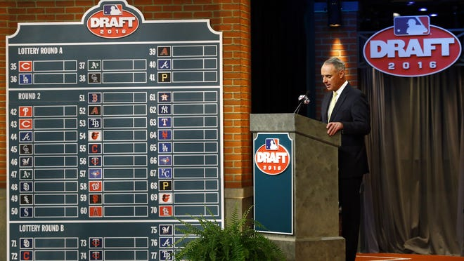 Major League BaseballCommissioner Rob Manfred speaks during the MLB draft, in Secaucus, N.J in 2016. Major League Baseball will cuts its amateur draft from 40 rounds to five this year, a move that figures to save teams about $30 million. Clubs gained the ability to reduce the draft as part of their March 26 agreement with the Major League Baseball Players' Association.