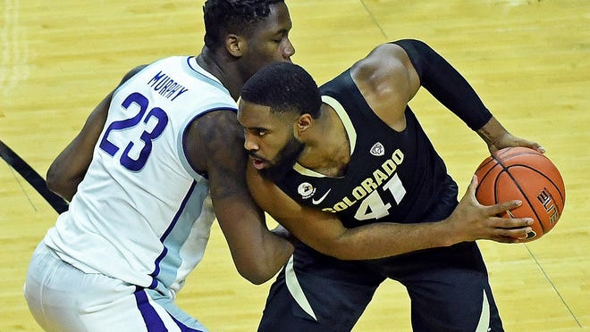 Kansas State forward Montavious Murphy defends against Colorado's Jeriah Horne during Friday's game at Bramlage Coliseum.