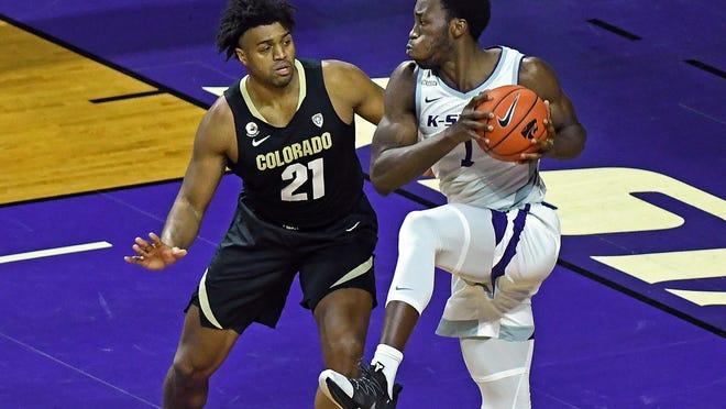 Kansas State post player Kaosi Ezeago battles inside against Colorado forward Evan Battey last Friday at Bramlage Coliseum.