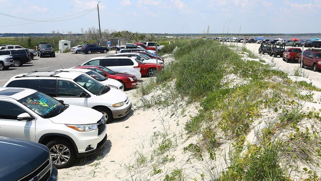 Public beach accesses were at capacity Saturday at North Topsail Beach as friends and families headed to the beach to celebrate Fourth of July. It is currently free to park at town accesses but North Topsail Beach is considering the idea of paid parking.
