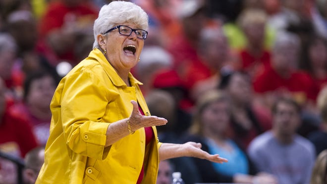 Indiana Fever head coach Lin Dunn reacts toward the officials on the court during the first half of a WNBA basketball game, Saturday, July 12, 2014, at Bankers Life Fieldhouse in Indianapolis.