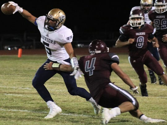 Tularosa's Toby Carrillo, right, tries to bring down Ruidoso's Isaiah Otero on Friday night.