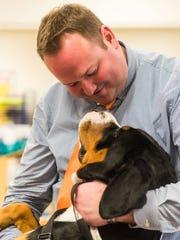Dr. Dan Dooley gives Skye a hug at Haleyville-Mauricetown