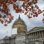 FILE - This Nov. 13, 2014, file photo shows the U.S. Capitol Dome, in Washington, surrounded by scaffolding for a long-term repair project, and framed by the last of autumn's colorful leaves.  Like a student who waited until the night before a deadline, lawmakers resuming work Monday will try to cram two years of leftover business into two weeks while avoiding a government shutdown. (AP Photo/J. Scott Applewhite, File)