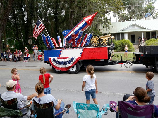A float loaded with a rocket, cannons, and firecrackers