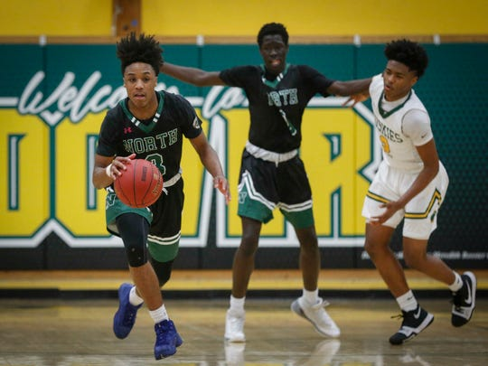 Des Moines North junior point guard Tyreke Locure runs up court against Des Moines Hoover on Tuesday, Jan. 9, 2018, at Hoover High School in Des Moines.