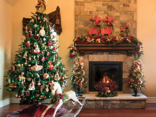 Homeowner Mary DeMatteo displays Christmas ornaments she's collected over the years on her living room tree. Antique-looking rocking horse and lighted trees in urns: Eurica Home, Wyckoff