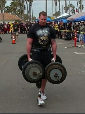 Visalia's Chad Macklin competes in the California's Strongest Man competition in March.