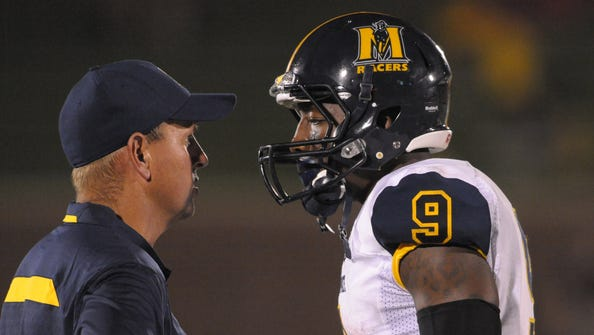 Murray State Racers head coach Chris Hatcher talks with wide receiver Walter Powell (9) in a time out during the second half of the game against the Missouri Tigers at Faurot Field on August 31, 2013.