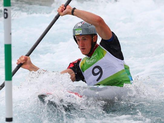 Michal Smolen competes Aug. 10 in men's K1 kayak semifinals