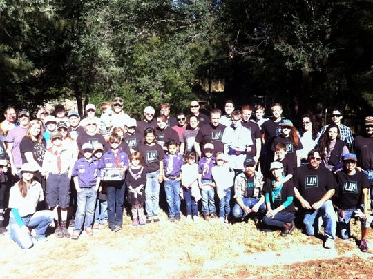 Many of the volunteers who helped clean up trash along the rivers in Ruidoso posed for a picture after the work.