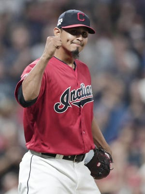 Cleveland Indians relief pitcher Carlos Carrasco pumps his fist after the Indians defeated the Philadelphia Phillies 5-2 in a baseball game, Friday, Sept. 20, 2019, in Cleveland.