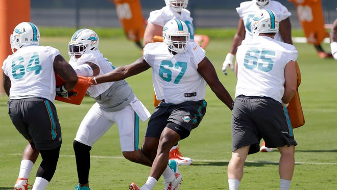 Miami Dolphins offensive tackle Laremy Tunsil (67) performs a drill on Thursday during NFL football practice in Davie, Fla.