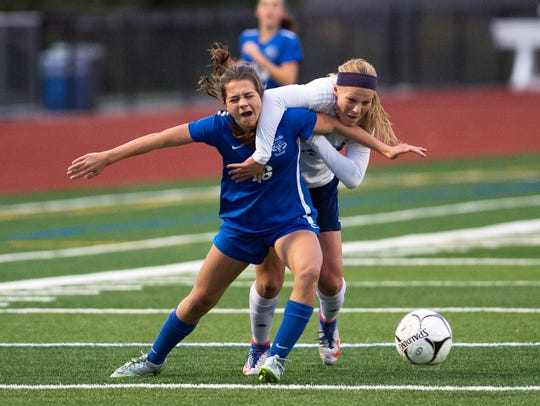Bronxville defender Clio Dakolis, left, fights for
