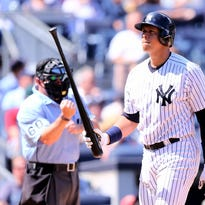 Alex Rodriguez of the New York Yankees walks back to the dugout after he struck out in the sixth inning against the Toronto Blue Jays on August 9, 2015 at Yankee Stadium in the Bronx borough of New York City.