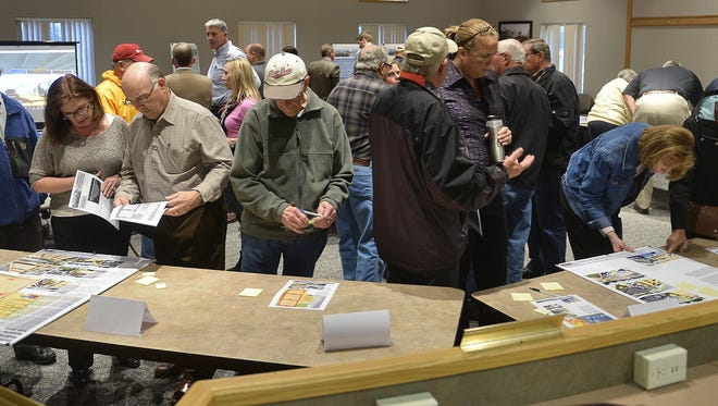 Sartell residents look over information on the proposed Sartell community center project earlier this year at Sartell City Hall.