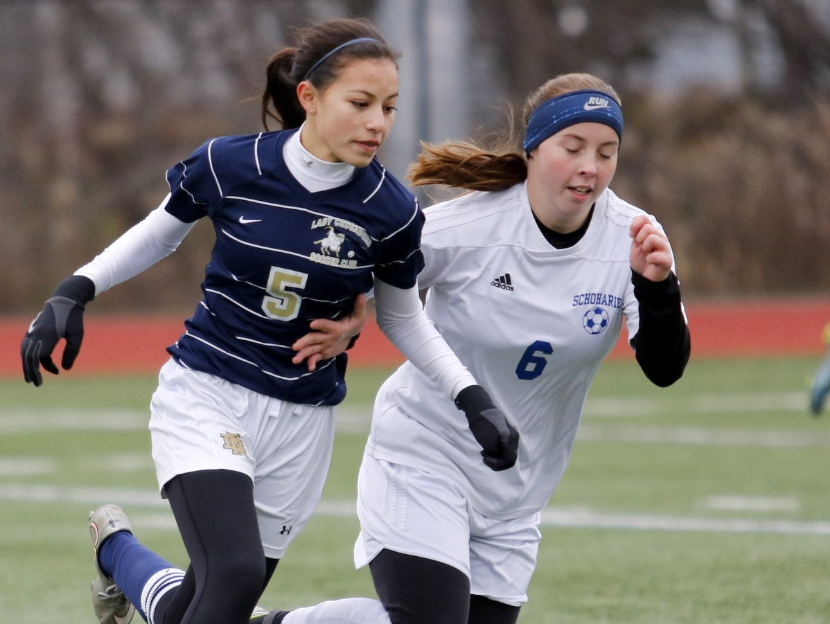 Notre Dame's Laurel Vargas fights for possession of the ball with Schohaire's Caroline Wetsel during Saturday's Class C state semifinal at Cortland High School.