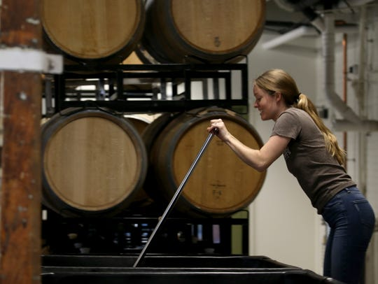Colleen Hardy punching down the cap on Cabernet Franc