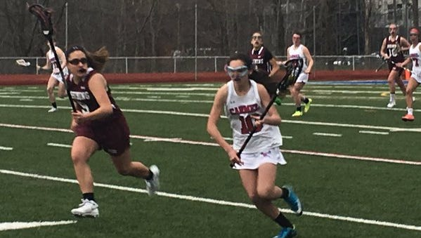 Game action during a girls lacrosse game between Carmel and Ossining at Carmel High School. Carmel won 14-7.