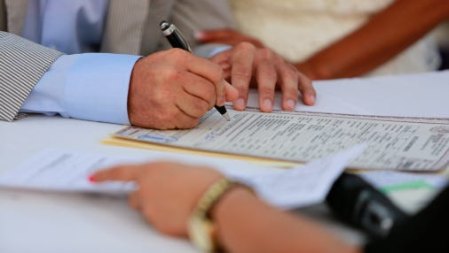 Signing marriage license