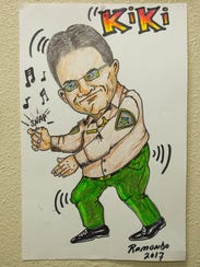 "A caricature of Sheriff Enrique Vigil ""Kiki""that was"