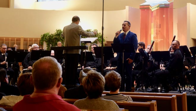Artistic Director Dean McDowell conducting, vocalist Charles Herrera.