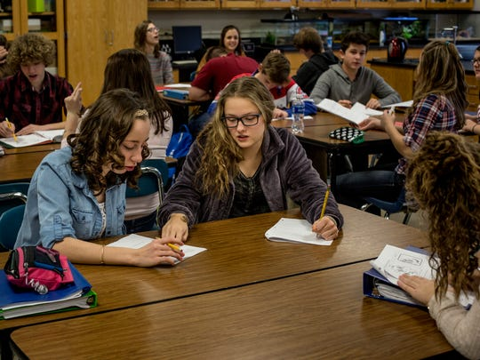 Amberley Sazehn and Maci Chamberlin, both 14, work on a lesson together during a freshman biology class Thursday, Jan, 5, 2017 at St. Clair High School.