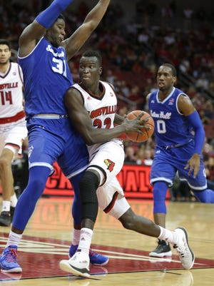Louisville's Deng Adel drives around Seton Hall's Angel Delgado during second half action. Dec. 3, 2017.