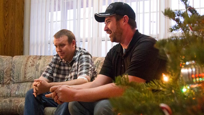 Brothers Eric (left) and Kyle (right) Stapley talk with Spectrum News reporter Bree Burkitt at their parent's home in Cedar City, December 11, 2017.
